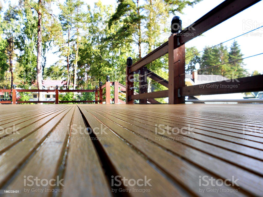 Wooden terrace seen from the floor stock photo