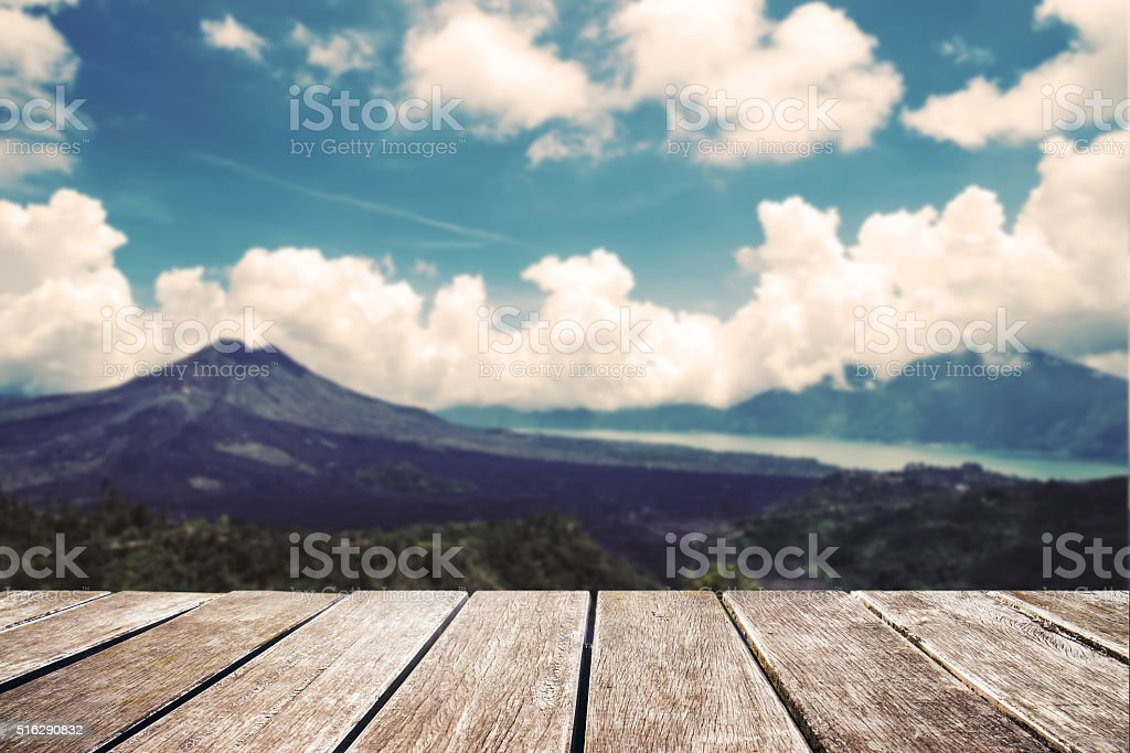 Wooden terrace with blurred de focus landscape of mountain stock photo