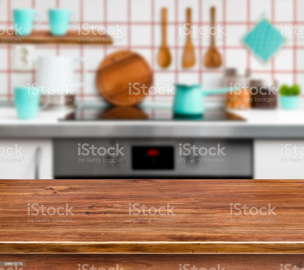 Wooden texture table on defocused modern kitchen background stock photo