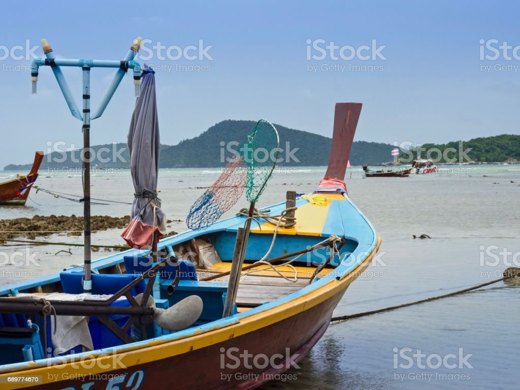 Wooden Thai Taxi -Boats On Island Background stock photo