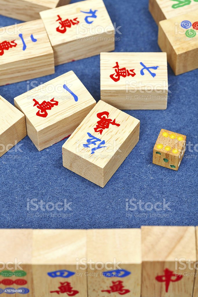 wooden tiles in mahjong game on blue cloth table stock photo