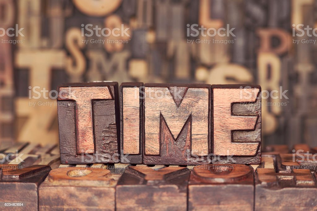 wooden TIME concept stock photo