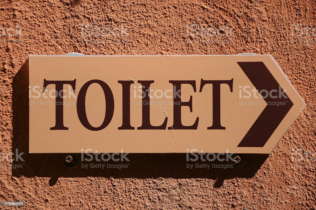 Wooden Toilet Sign On The Wal. royalty-free stock photo