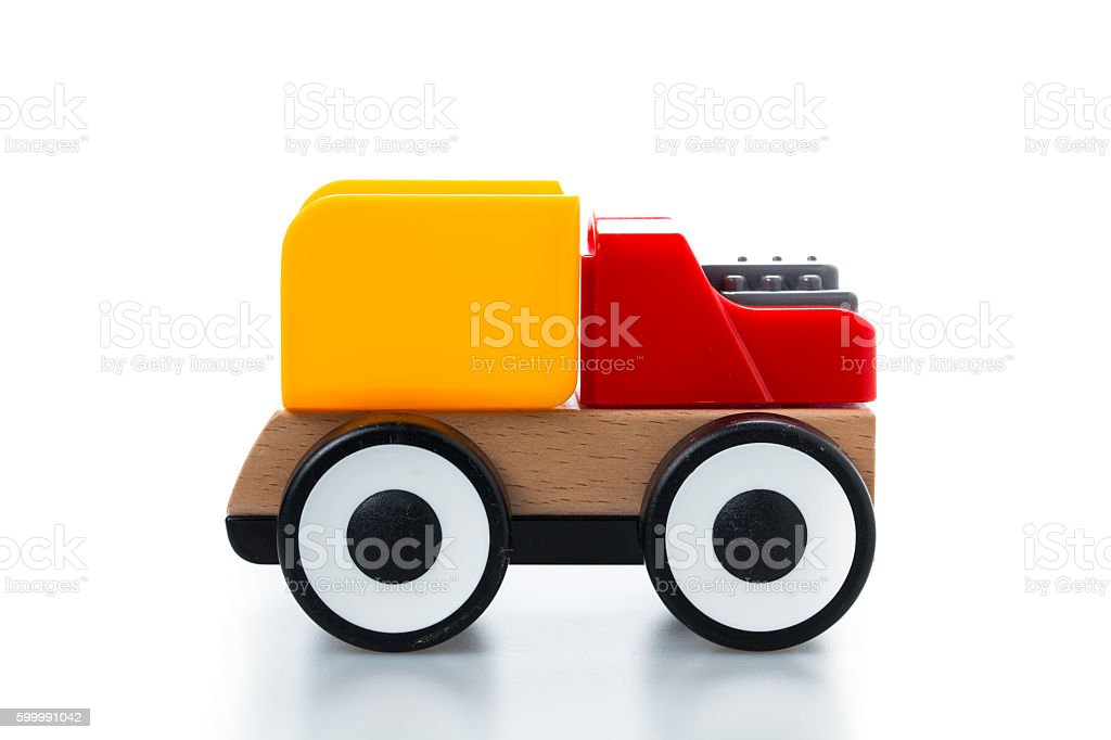 Wooden toy car on white background stock photo