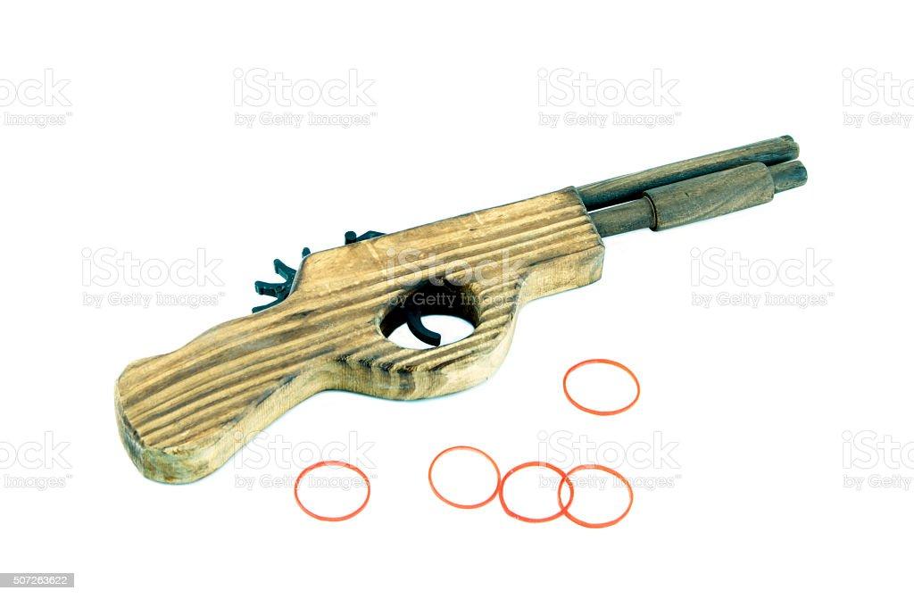 Wooden toy gun on a white background. stock photo