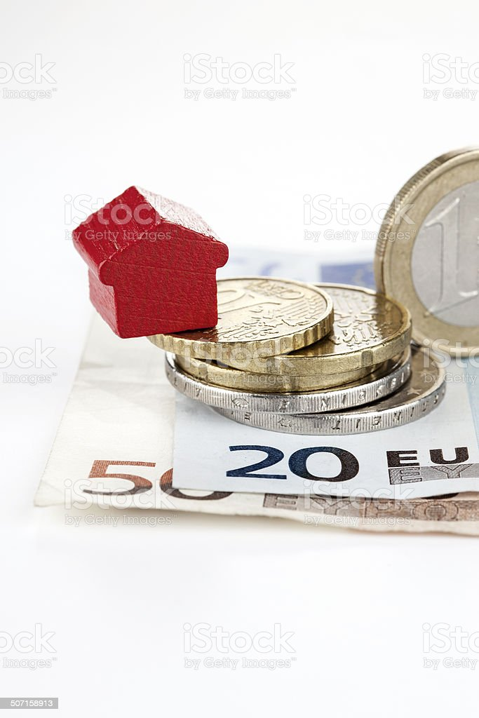 Wooden toy house and european currency royalty-free stock photo