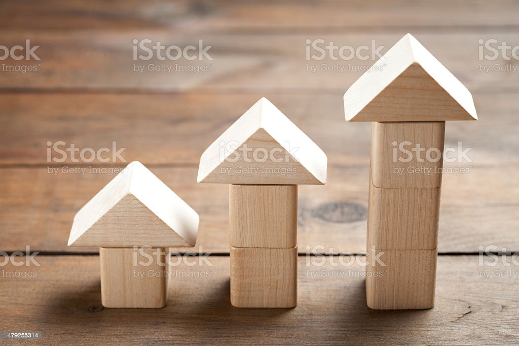 Wooden toy houses on old table stock photo