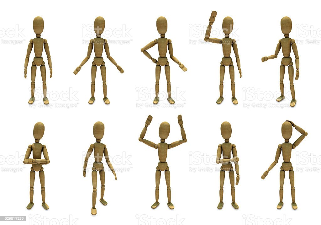 Wooden toy in different poses stock photo