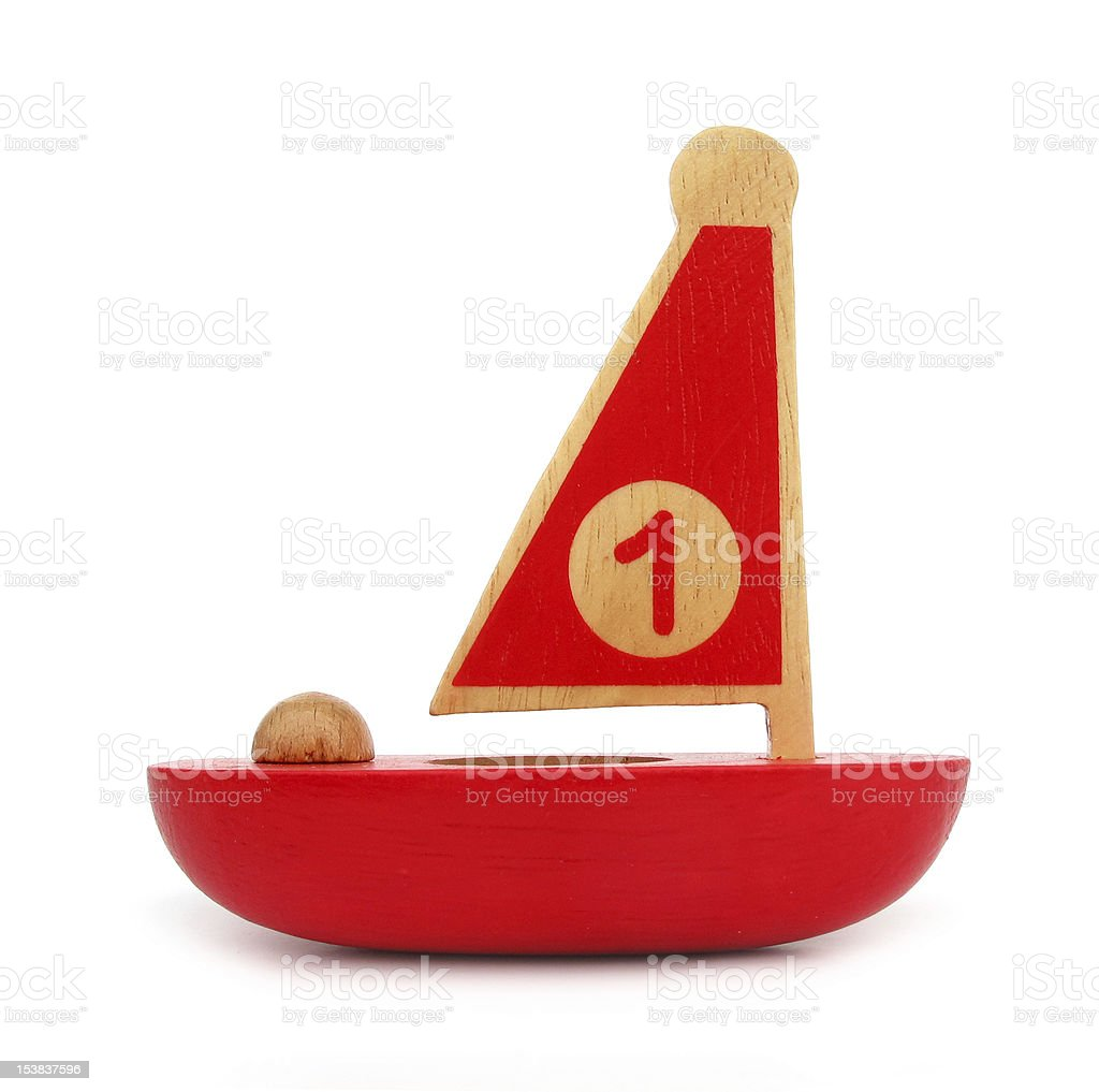 Wooden toy sailboat stock photo
