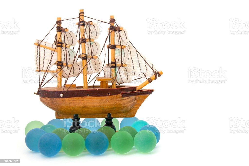 wooden toy ship at sea isolated overwhite stock photo
