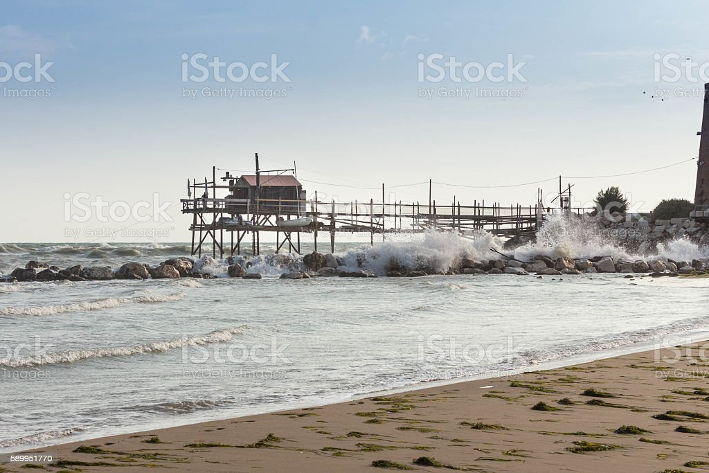 Wooden Trabucco over rough sea, Termoli, Molise, Italy stock photo