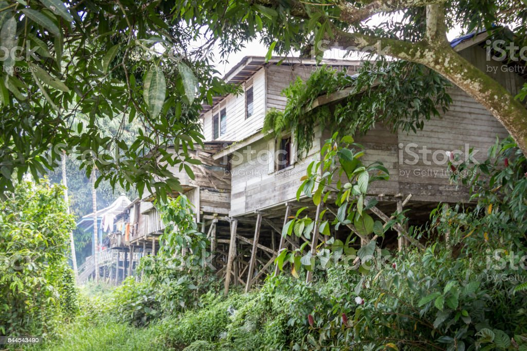 Wooden traditional house on the coast of the river kalimantan stock photo