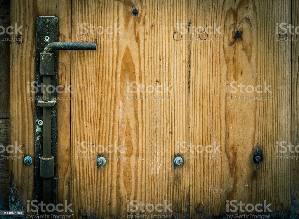 Wooden trap door with iron latch stock photo