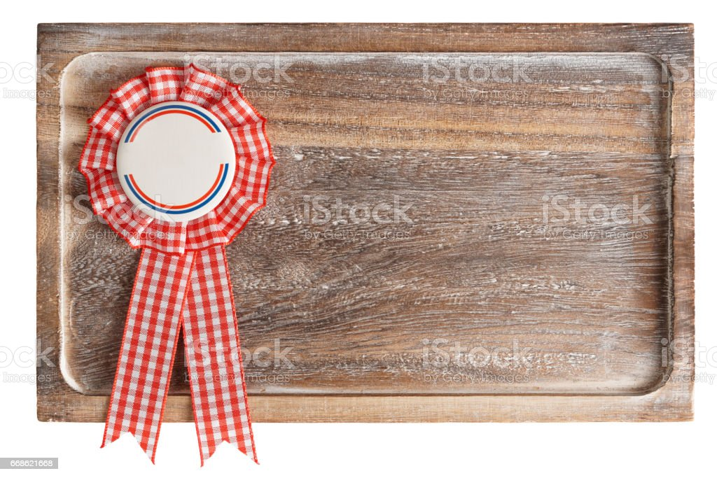 Wooden tray with round ribbon seal, isolated on white stock photo