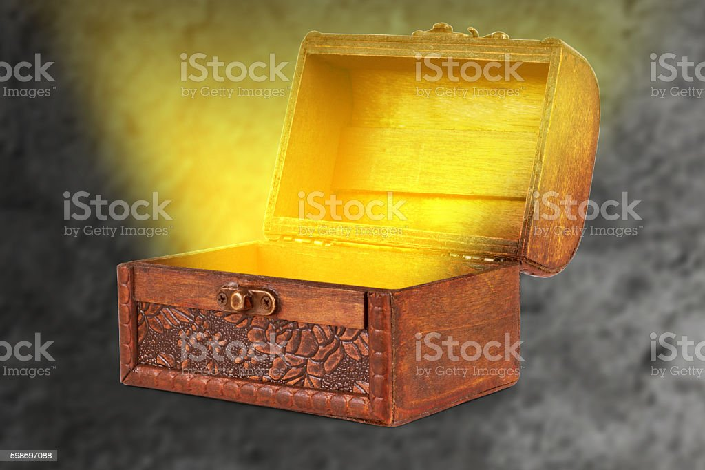 wooden treasure chest with a magical wispy light coming stock photo