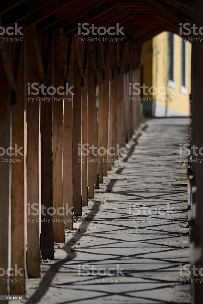 Wooden tunnel over a pavement at a contstruction stock photo