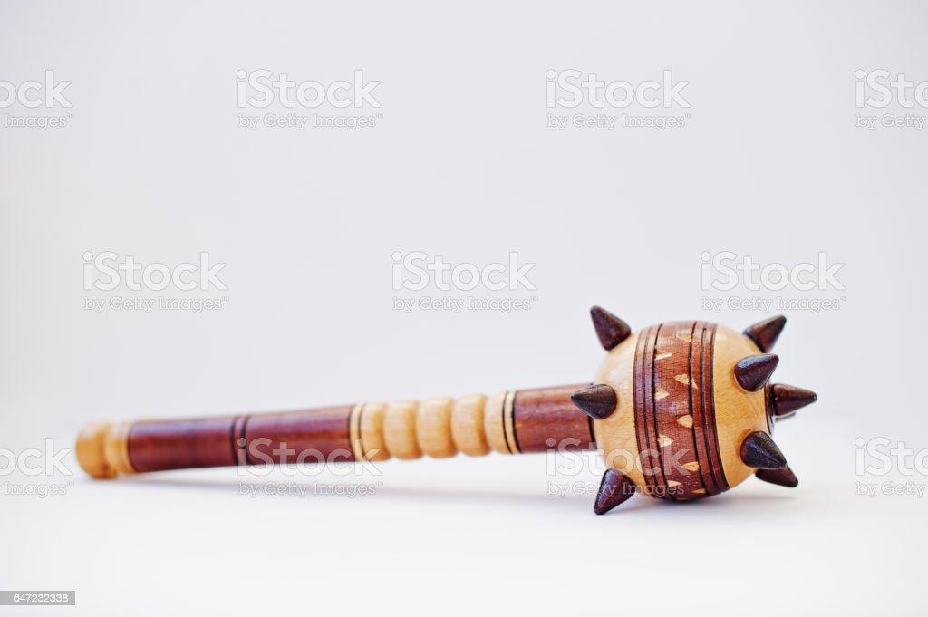Wooden ukrainian traditional mace isolated on white background. stock photo