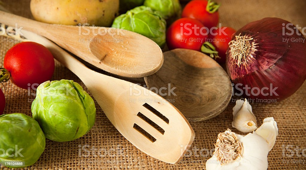 Wooden utensils and vegetables royalty-free stock photo