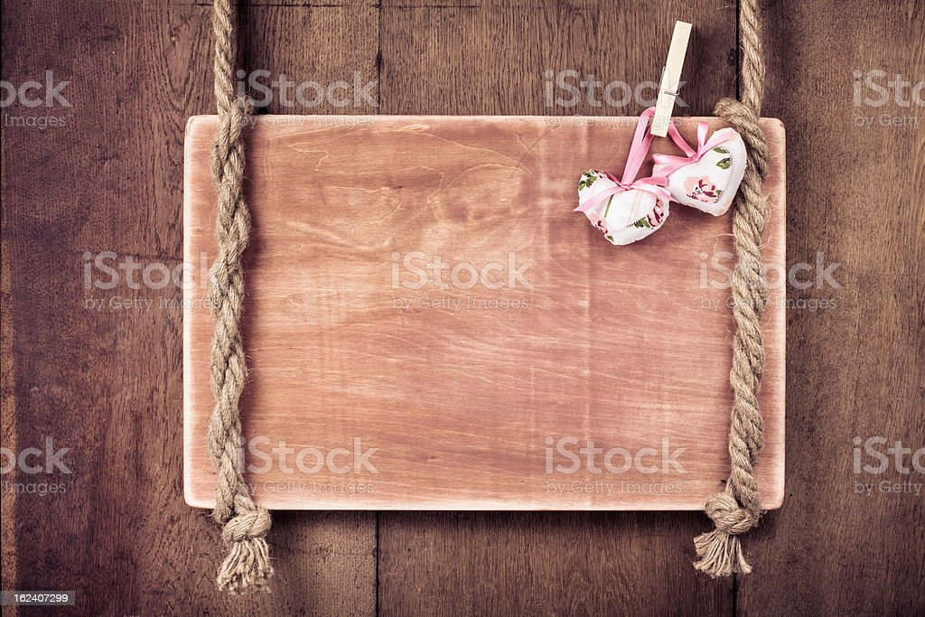 Wooden Valentine background with hearts hanging on rope royalty-free stock photo