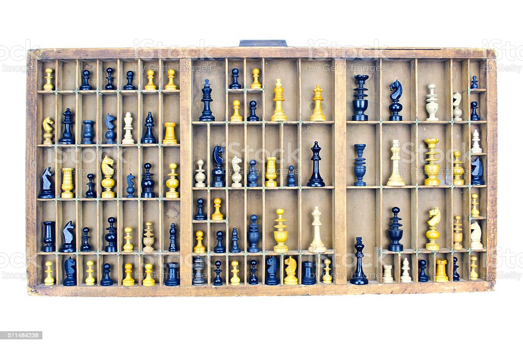 Wooden vintage partitioned drawer shelf with chess figures stock photo