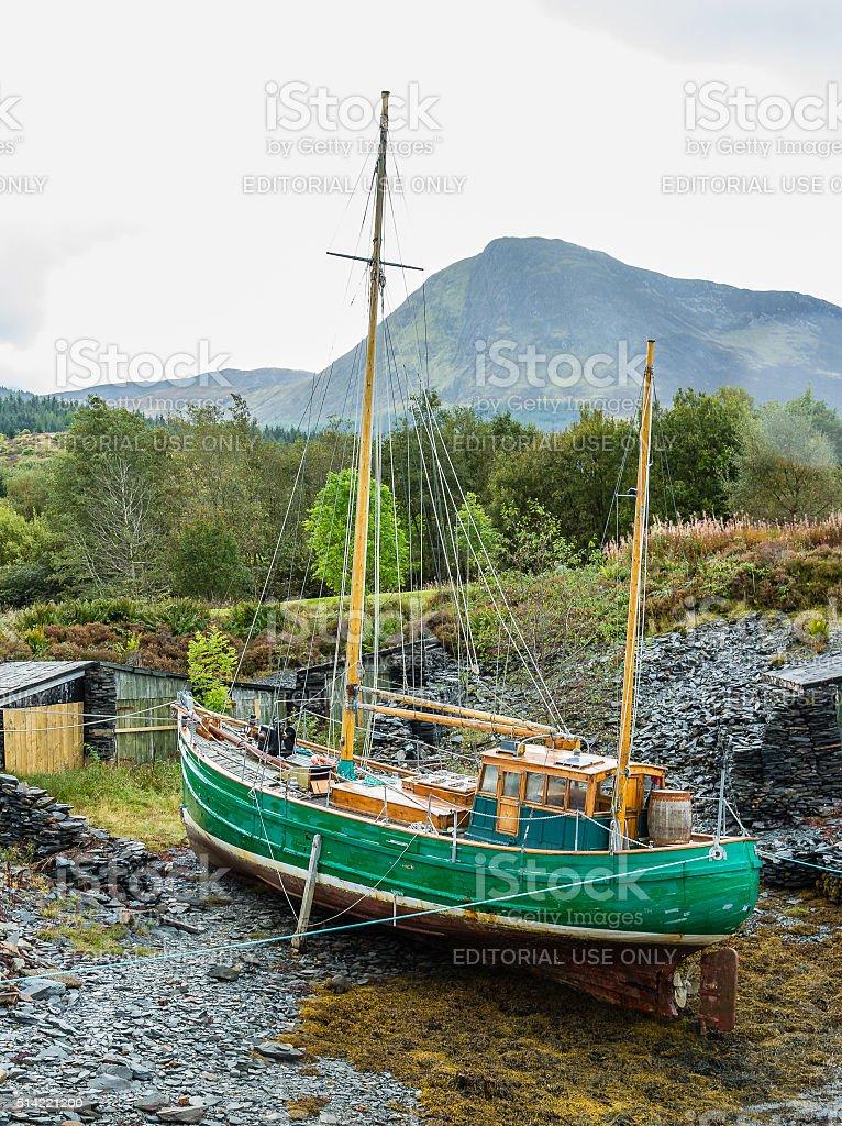 Wooden vintage schooner sailboat dry docked at Loch Leven stock photo