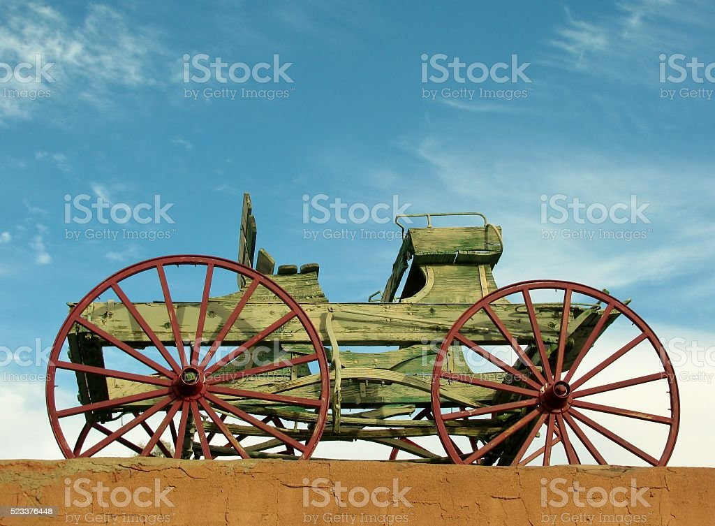 Wooden waggon on the roof against blue sky stock photo