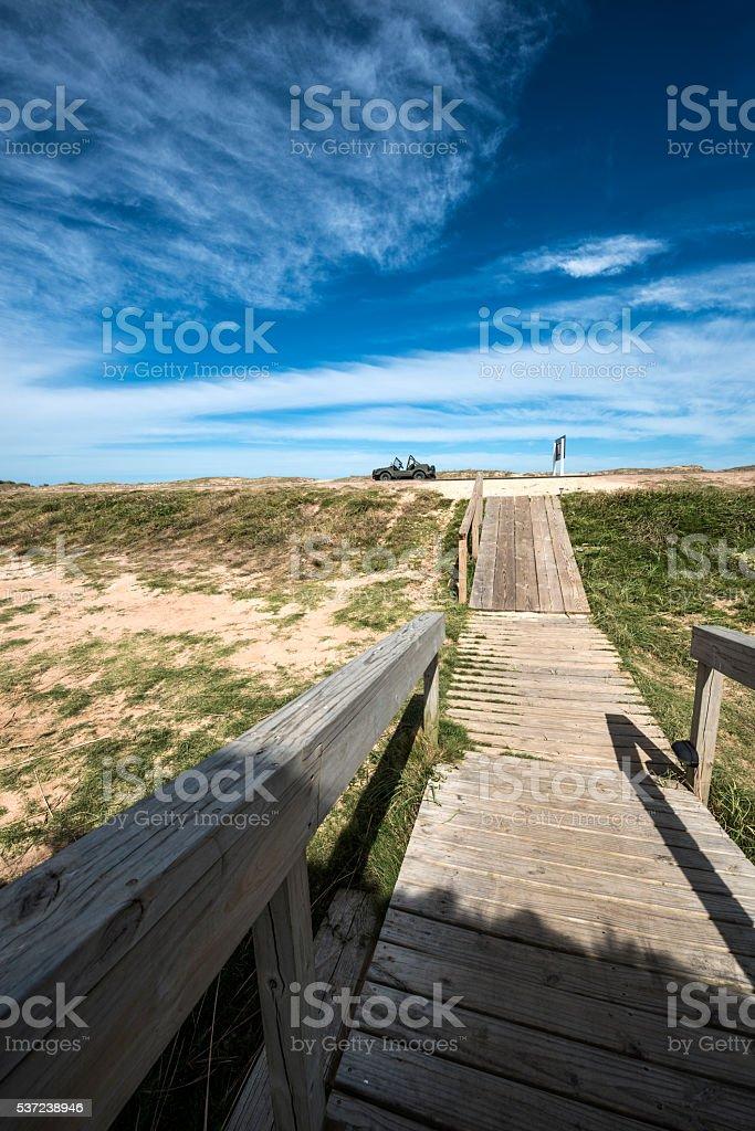 Wooden walkway across the beach, Jose Ignacio, Uruguay stock photo