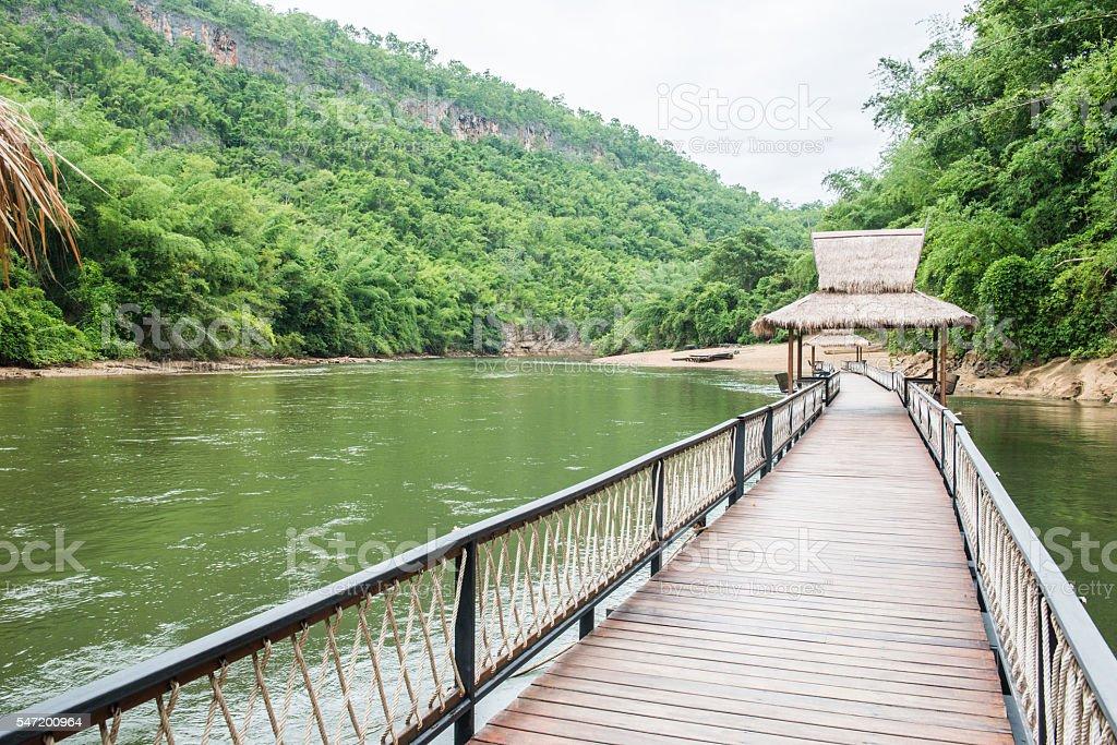 Wooden walkway along the creek stock photo