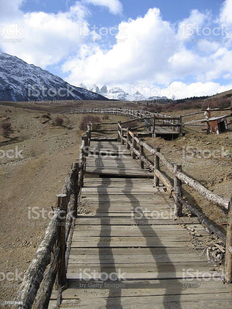 Wooden walkway leading to Jade Dragon Snow Mountain in China royalty-free stock photo