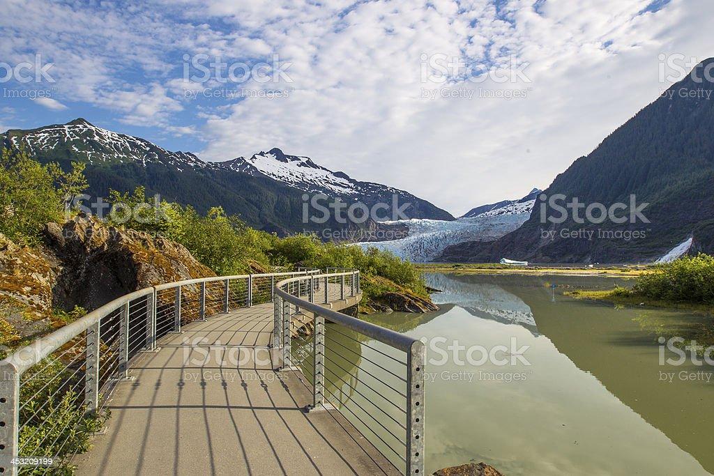 Wooden walkway near river going through Glacier Path  stock photo
