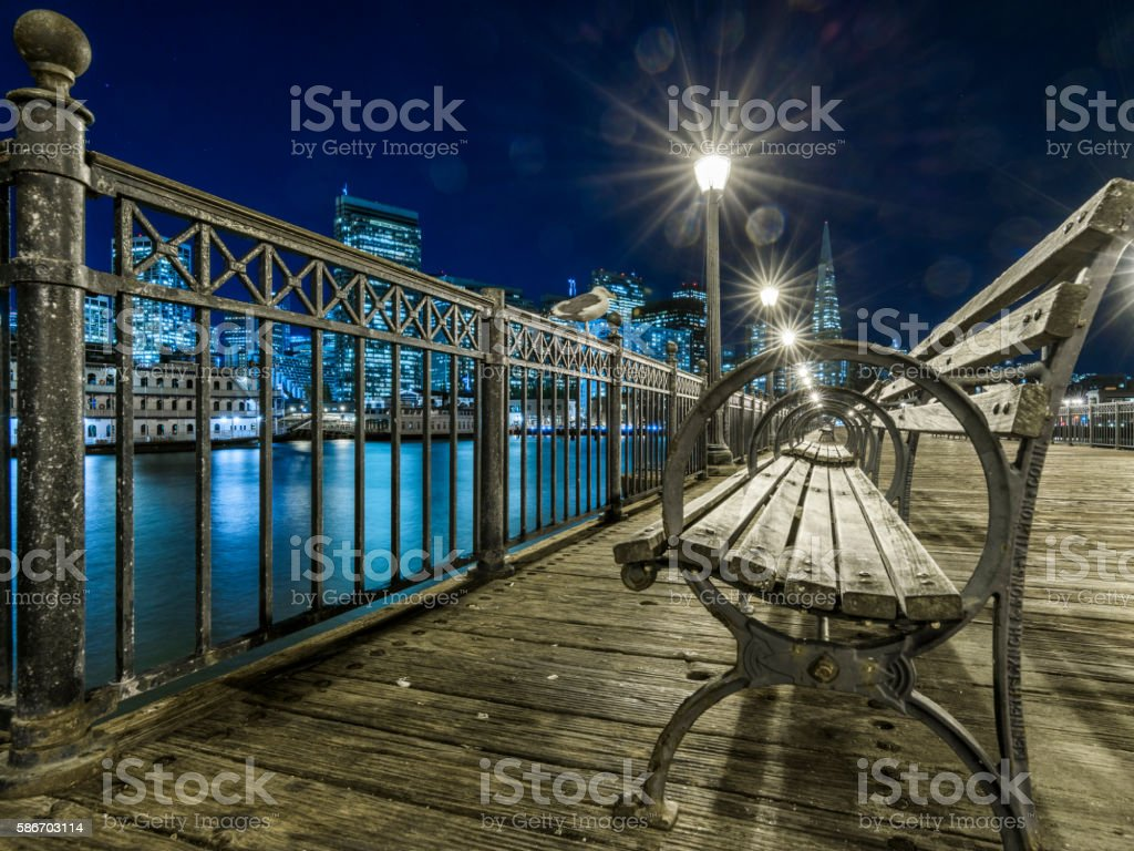 wooden walkway to downtown stock photo
