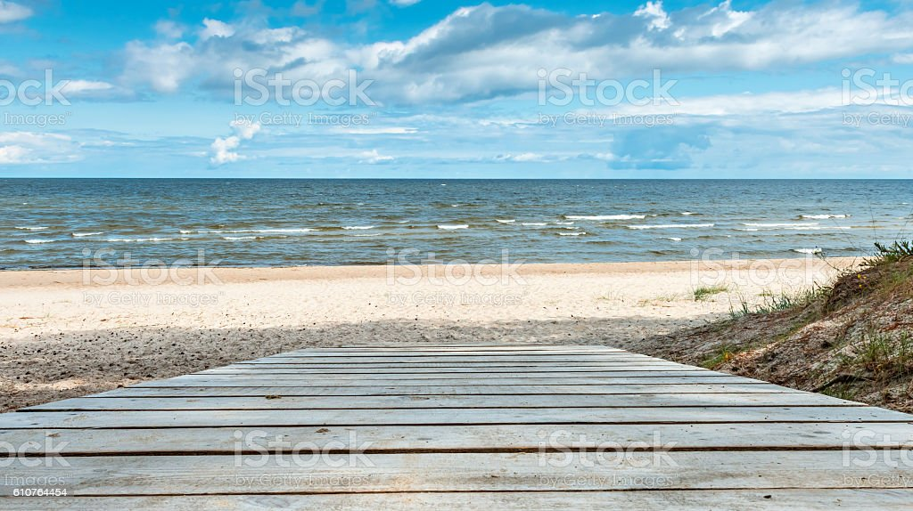 Wooden walkway to the sand beach, Baltic Sea stock photo