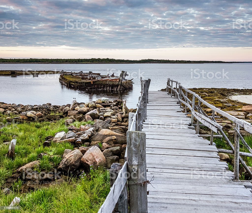 Wooden walkways on shore stock photo