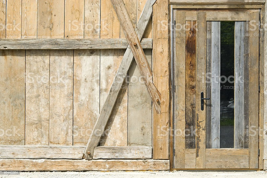 Wooden wall and a door stock photo