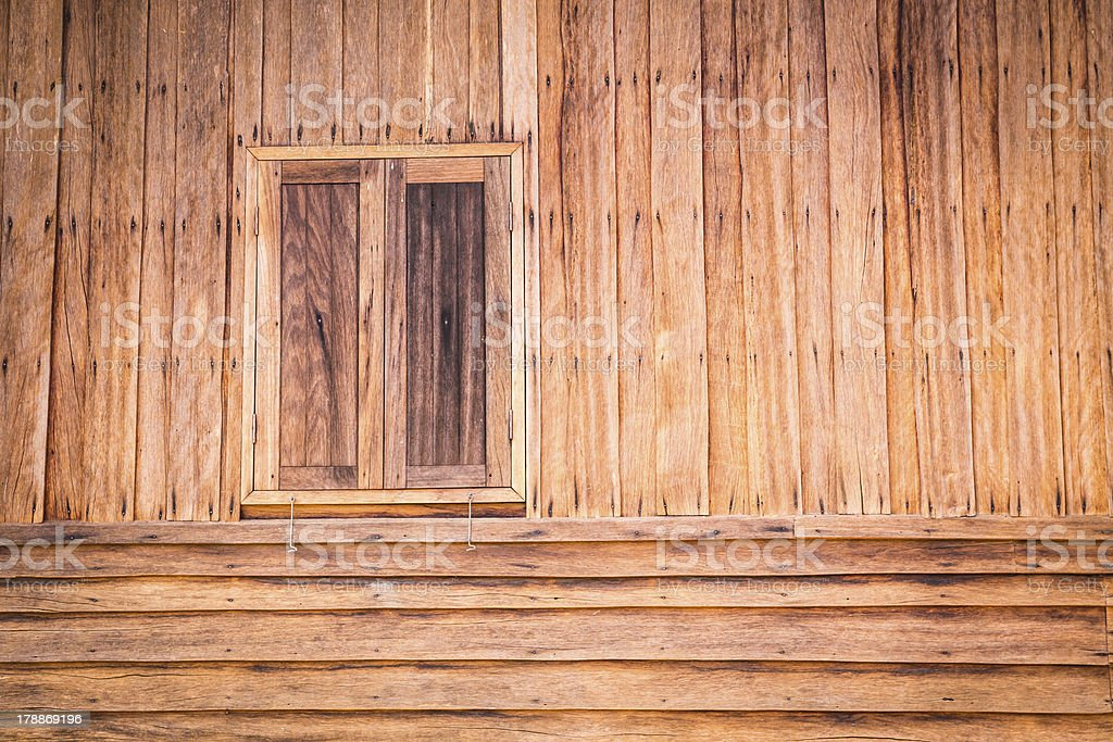 Wooden wall of ancient house with window closed stock photo