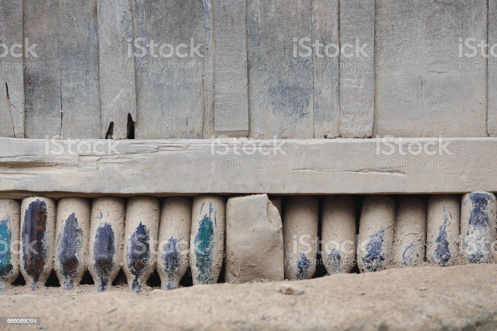 Wooden wall on bottles-Akha hill tribe village. PakNamNoy area-Phongsali province-Laos.3805 stock photo