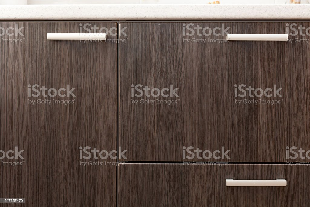 Wooden wardrobe drawer front, metal handle stock photo
