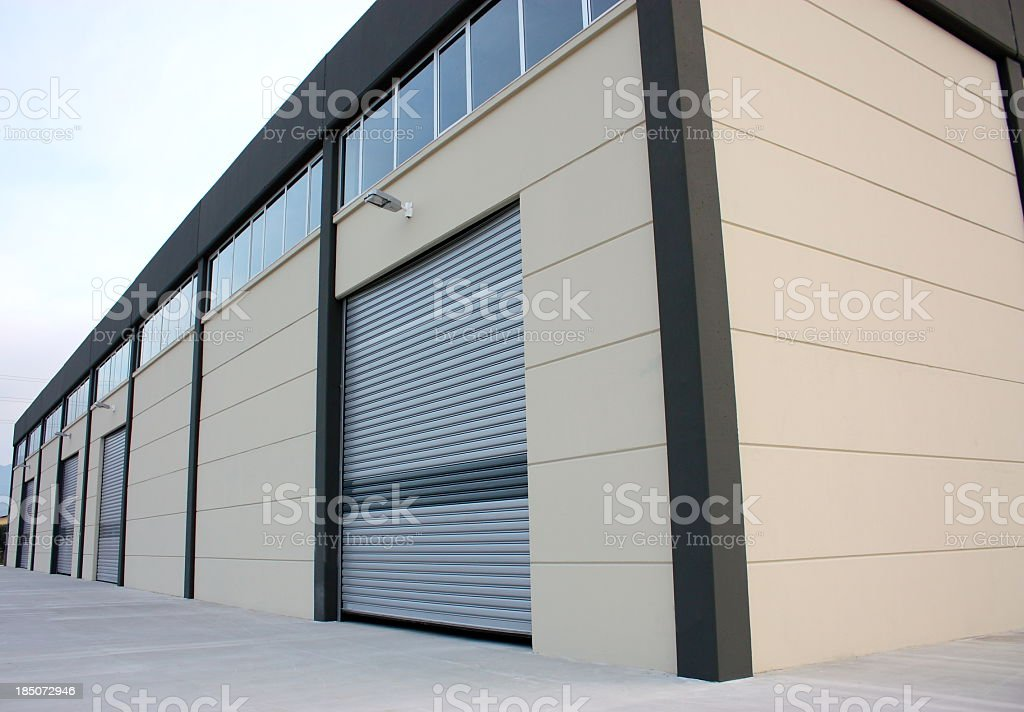A wooden warehouse building lit up by the sun stock photo