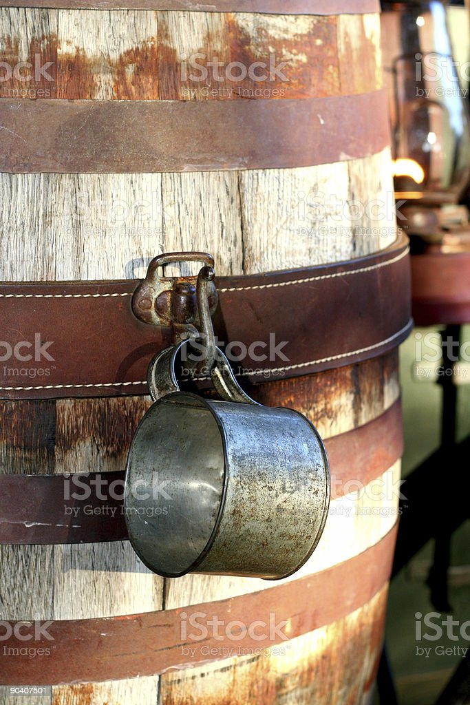 wooden water barrel and cup stock photo
