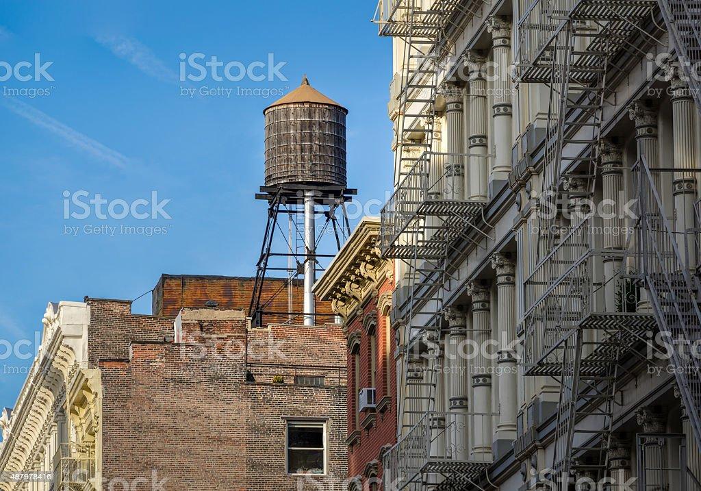 Wooden water tank and cast iron facades, Soho, New York stock photo