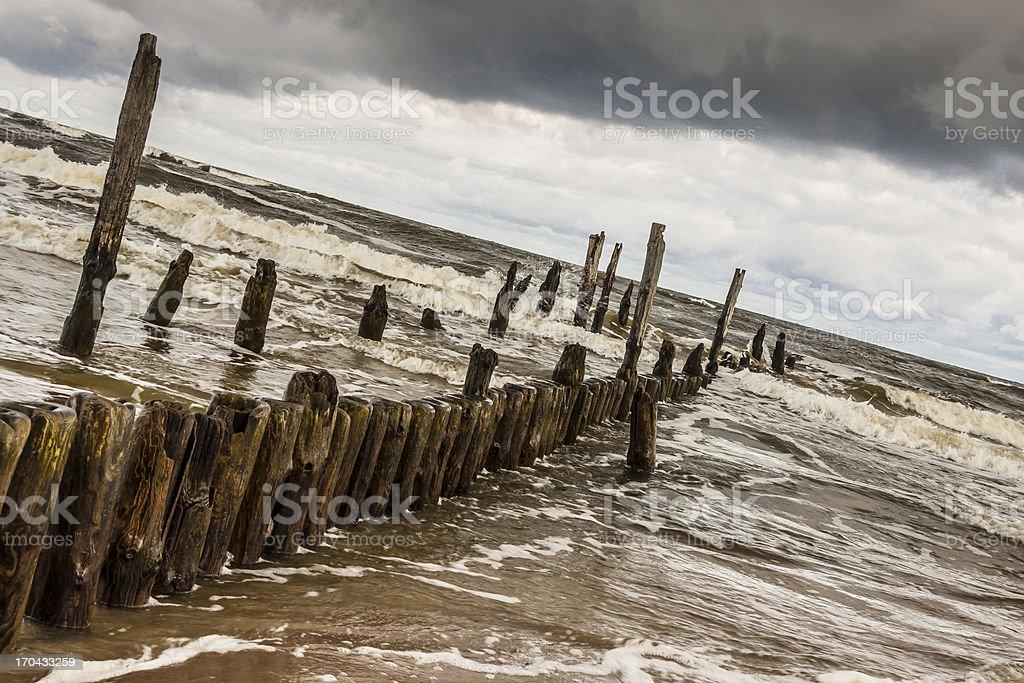 Wooden waterbreaks - Rewal Poland. stock photo