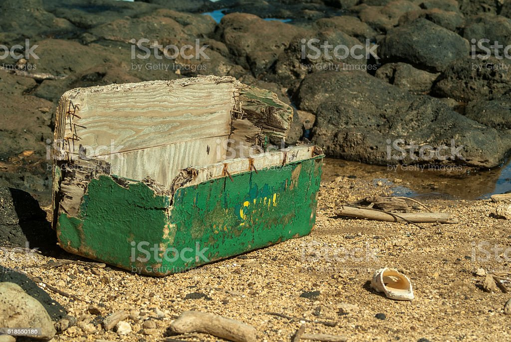 Wooden weathered chest washed up onto the beach stock photo