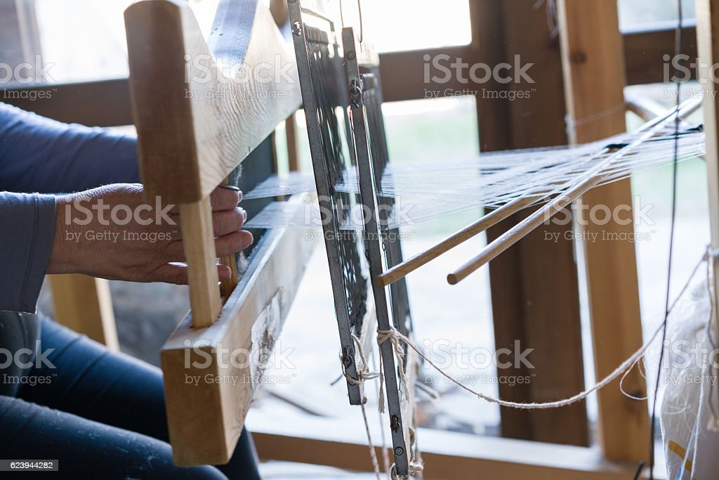 wooden weaving shuttle for homemade silk or textile production stock photo