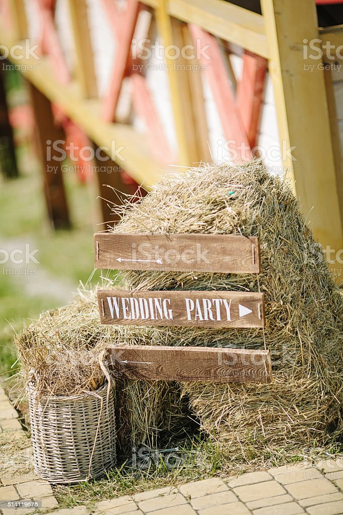 Wooden wedding sign with indication of direction stock photo