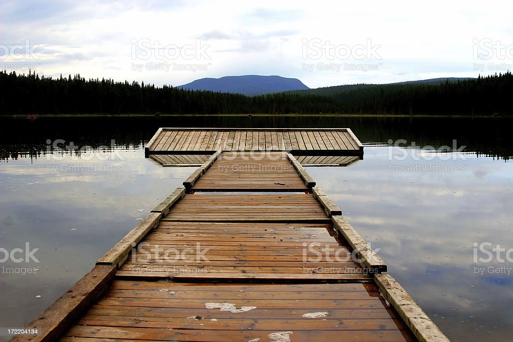 A wooden wharf on a lake, Alberta Foothills, Canada. stock photo