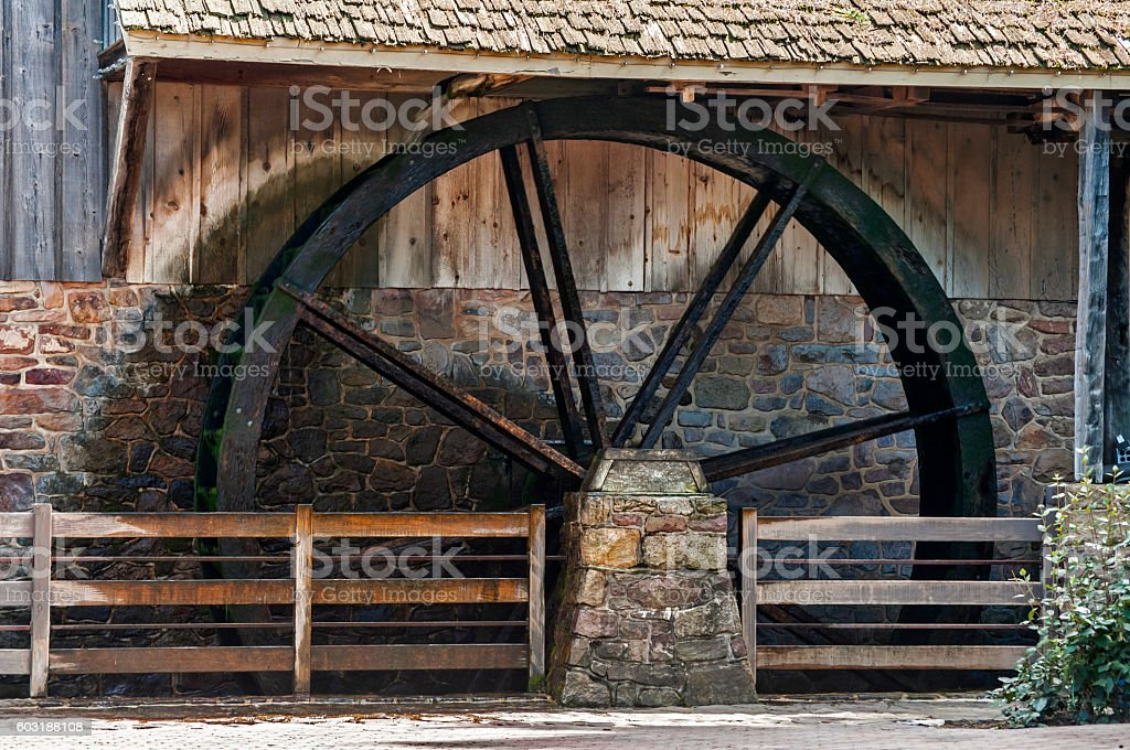 Wooden wheel of water mill stock photo