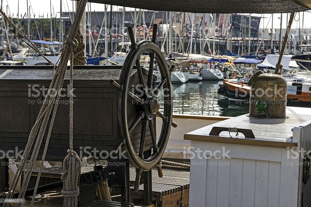wooden wheel sailboat stock photo