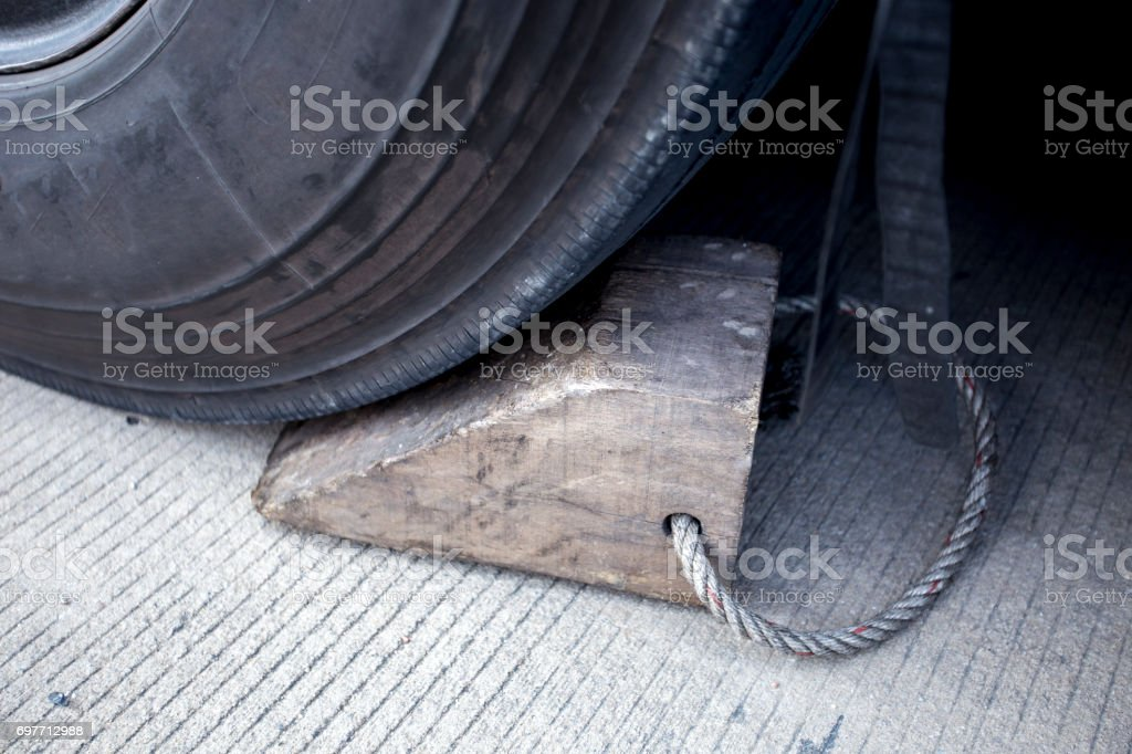 Wooden wheel stopper for big truck. stock photo