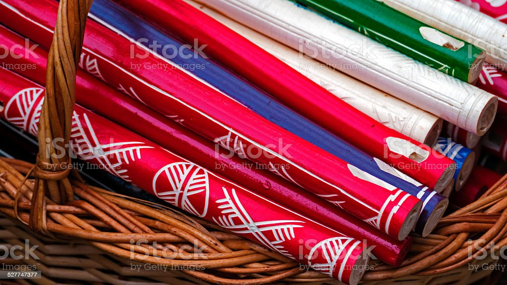 Wooden Whistles in a wicker basket stock photo
