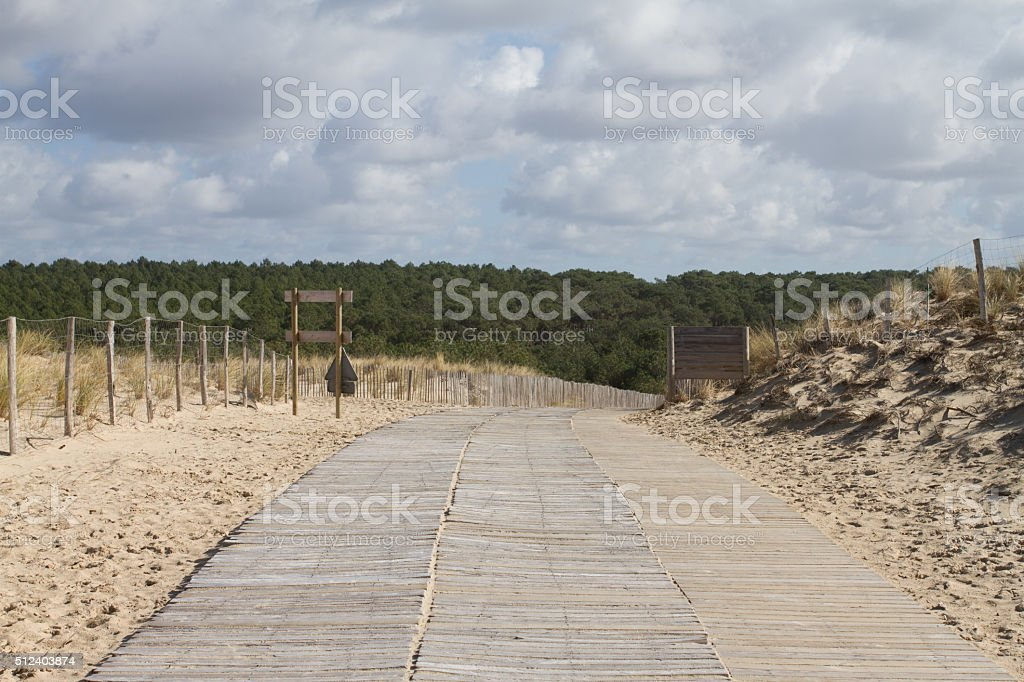 Wooden white path to the beach of the ocean stock photo